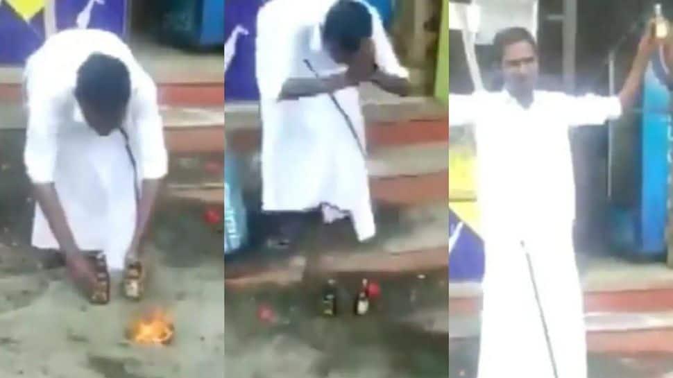 Watch viral video: மதுபாட்டில்களை கும்பிட்டு குடிக்கத் தொடங்கும் மதுரை குடிமகன்