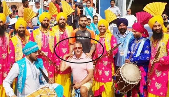 விராட் கோலியுடன் விஜய் மல்லையாவா?; குழம்பிபோன ரசிகர்கள் -Seepic!
