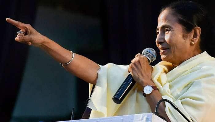 NRC பற்றி கவலை வேண்டாம்; BJP என்னை தாண்டி உங்களை தொட முடியாது: மம்தா