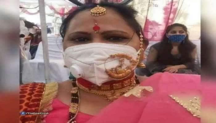 Fashion of Corona Period: மாஸ்குக்கு மேலே நகை அணிந்து ஃபேஷன் காட்டும் பெண்